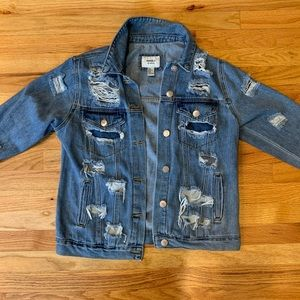 A ripped jean jacket
